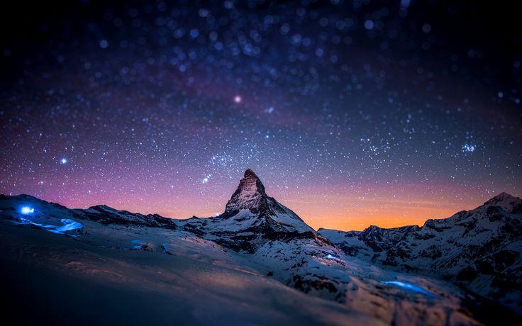 """Snow in the night sky of the Matterhorn in Switzerland"" (quote)"