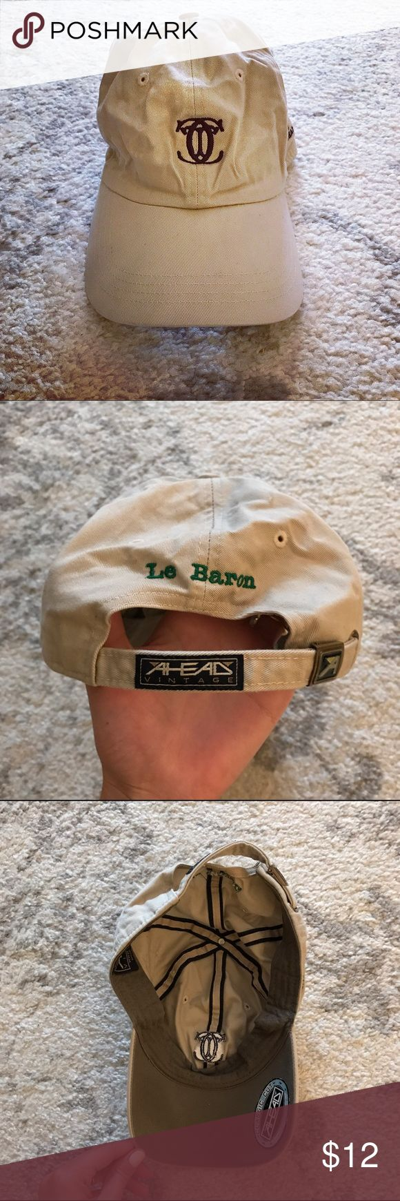 """Le Baron Country Club khaki golf hat Le Baron Country Club khaki cotton golf cap. The hat has the Le Baron Country Club logo sewn in black on the front of the cap, and """"Le Baron"""" sewn in green on the back of the cap. The hat has an adjustable strap in the back, and is meant to be one size fits all. On one side of the hat, """"2012 B-League Champions"""" is sewn small in black, and on the other side of the hat are other championship years sewn in black (2007, 2004, 2003, etc). In excellent…"""