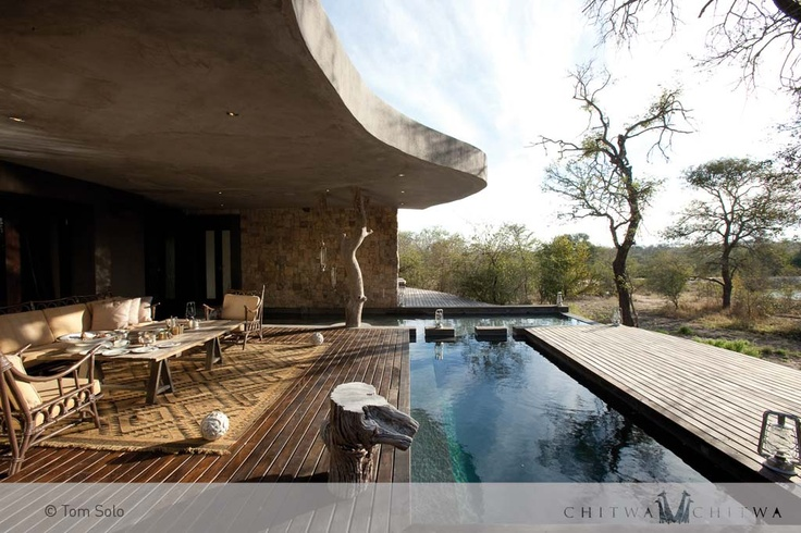 Well finished deck with a refreshing swimming pool to cool off in | The Charlsy Suite