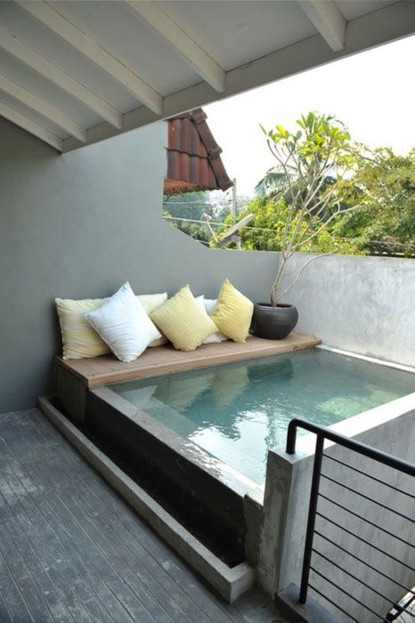Turn a small courtyard into a sanctuary by adding an outdoor hot tub! I would have a hot tub like this! It's private and looks so nice rather than those ugly big plastic things.