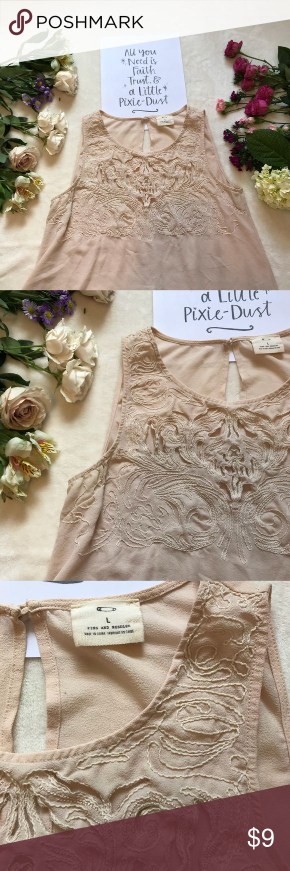 Nude tank top Cute nude color embroidered tank top. Some pink discoloration and a few tiny snags on the back (see last picture), but still has a lot of life left in it. Looks super cute with a lace bandeau underneath! 🤗 Pins & Needles Tops Tank Tops