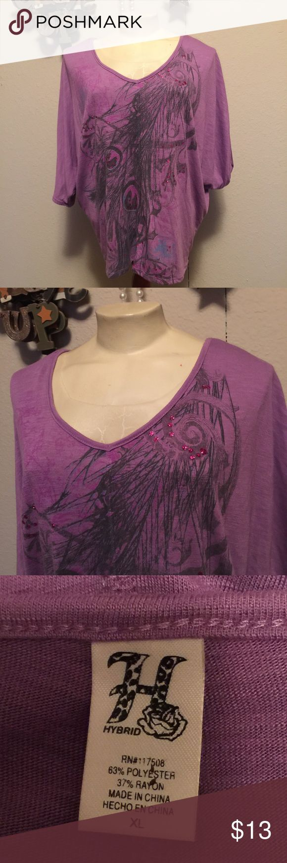 Purple dolman batwing peacock feather boho shirt Juniors size XL purple peacock feather batwing Dolman shirt.   ~ I am open to reasonable offers. ~Be sure to check out my other listings for more great items & save on shipping! ~I ship same day or next day.  ~ I do not hold items.   ~Not responsible for incorrect sizing. I go by what the tag says its up to the buyer to know their size. hybrid  Tops Blouses