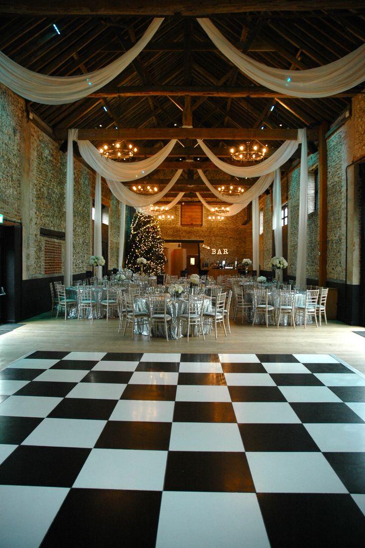 Winter Wedding Breakfast in The Granary Barn #winterwedding #granarybarns #dancefloor #draping #elizabethhalleventdesign