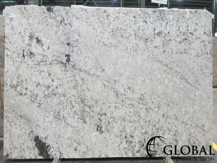 Dahlia White polished granite slab. Visit globalgranite.com for your natural stone needs.