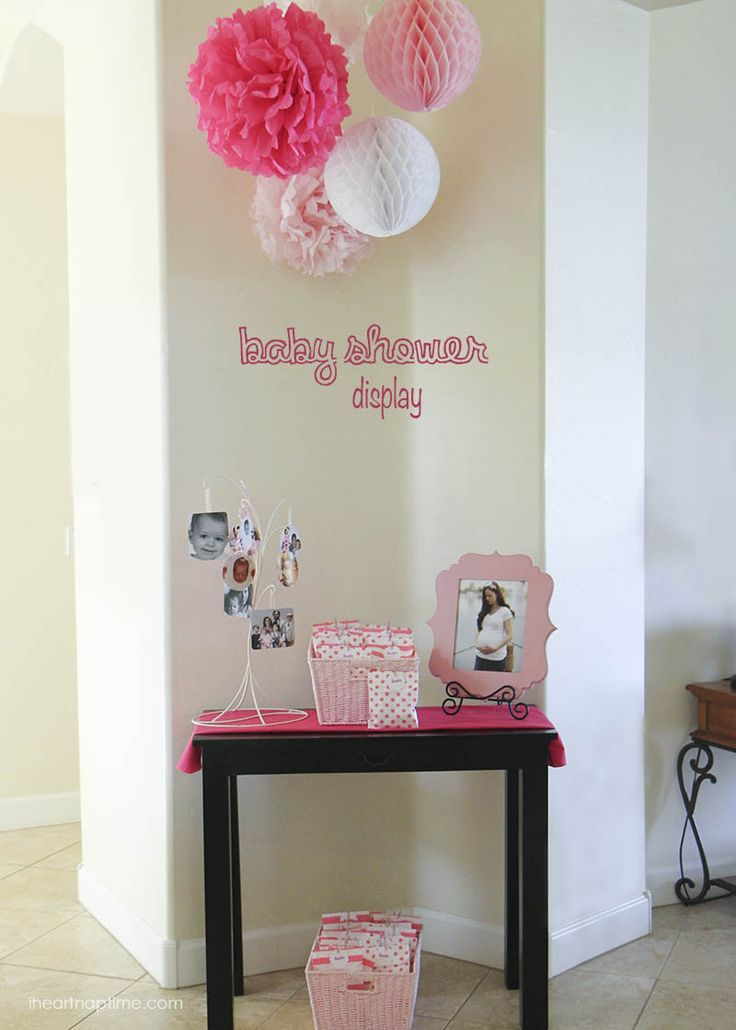 For the entry way we hung tissue poms and honey comb balls (with fishing line and command hooks) and displayed some pictures of my gorgeous friend Melissa. For the favors we put pink and white cookies in polka dot and striped bags closed with mini pink clothespins.