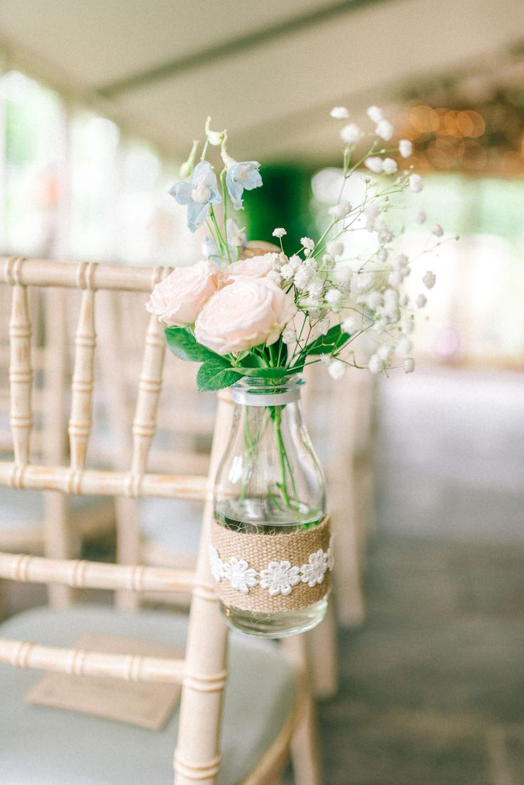 Milk Bottle wrapped in Hessian & Lace Chair Back Decor - Matt Ethan Photography | Vintage Pink Wedding at Newton Hall, Newton by the Sea