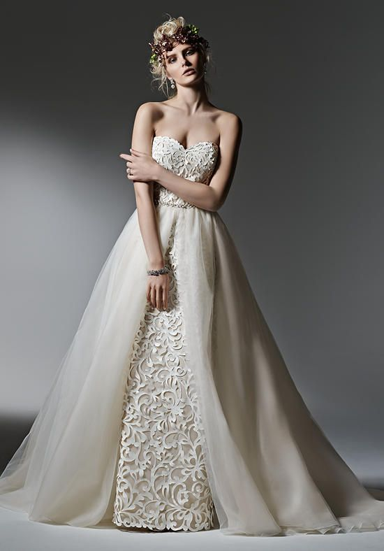 Dramatic laser cut leather lace creates this show-stopping sheath wedding dress, with a romantic sweetheart neckline | Sottero and Midgley | https://www.theknot.com/fashion/kristen-sottero-and-midgley-wedding-dress