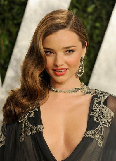 Celebrate Miranda Kerr's Birthday With Her Best Beauty Looks: Miranda sported a shorter crop and a pink bikini at the celebration of the 15th anniversary of the Victoria's Secret Swim catalogue in 2010.  : At the 2013 Vanity Fair Oscar Party, Miranda rocked Veronica Lake waves and a sexy tangerine lip.