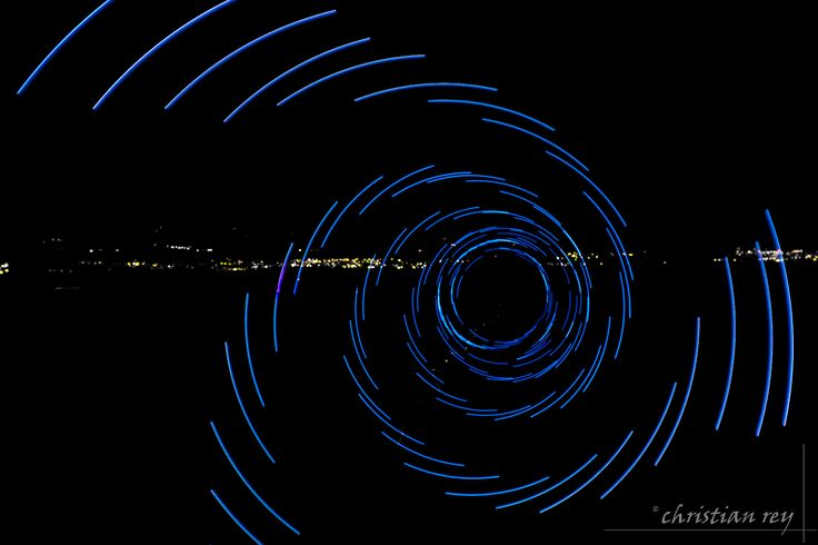 https://flic.kr/p/russcX | Light painting: The blue spiral | Réalisé avec une seule LED, la différence de vitesse de rotation et du clignotement donne l'impression d'avoir 3 leds distinctes. With one blinking led: the effect of 3 leds is generated with the unsynchronisation between the rotating speed and the flashing speed.