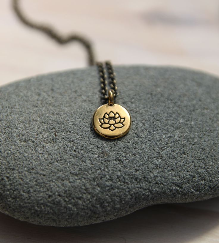 One of my favorite sayings is: No mud, no lotus. This necklace includes a pendant with a lotus flower etched onto it. The lotus flower grows in water, with its roots in the mud below and its bloom appear a few centimeters above the water. Lotus plants can live over 1,000 years and they have spiritual significance in several spiritual traditions. My hope is that this necklace reminds you that the tough stuff in your life becomes compost for all the goodness that blooms within.