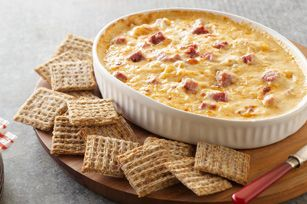Warm Reuben Spread (Kitchendaily.com): INGREDIENTS: 4 oz Cream Cheese, softened ½ c thousand island dressing ¼ lb sliced deli corned beef, chopped (about 1 c) ¾ cup well-drained Sauerkraut 8 oz Swiss Cheese Slices, chopped Triscuit deli-style rye cracker DIRECTIONS HEAT oven to 350ºF. MIX cream cheese & dressing in medium bowl with all ingredients except crackers. SPREAD in bottom of pie plate/shallow dish. BAKE until heated through. Serve warm w/crackers.