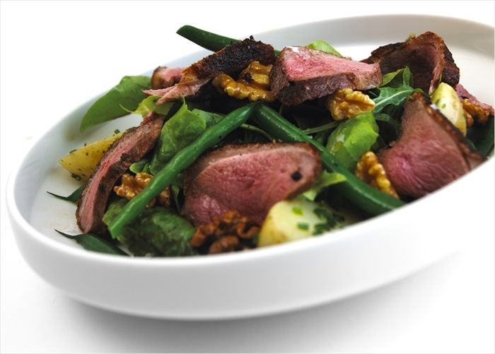Roast Gressingham Duck® breast salad with a honey and walnut dressing.