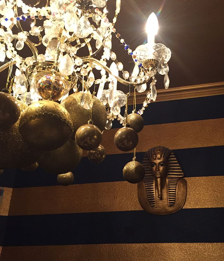 2015 fad - hanging balls from our chandeliers. In my Texas dining room (Egyptian theme, can you guess?).  The gold balls look fabulous over table!