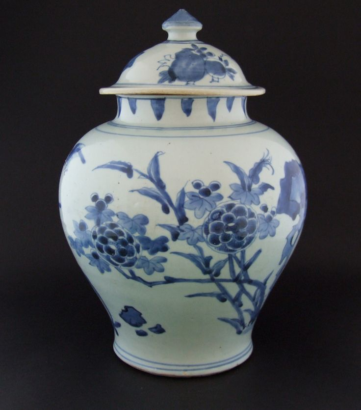 A Transitional Blue and White Porcelain Baluster Jar and Cover, Late Ming or Early Qing Dynasty, Late Chongzhen or Shunzhi Period c.1640-1660. Painted with Flowering Plants and Rocks.