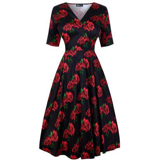 """Černé šaty s růžemi Lady V London Estella Krásné šaty pro dámy plus size z londýnské módní dílny, které využijete do společnosti, do divadla, na večírek i na běžné nošení. Výrazný vzor červených růží na černém podkladu, příjemný lehce pružný materiál (97% bavlna, 3% elastan).Výstřih do V (napevno šitý, neotvírá se), krátký rukáv, rozšířená sukně s pravidelnými sklady, pas projmutý, zapínání na krytý zip v bočním švu. Pro bohatší objem sukně doporučujeme doplnit spodničkou v délce 25 - 27""""…"""