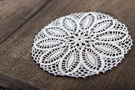 A small cotton lace Doily. The pattern by Bernadette Baldelli and Marie-Noelle…
