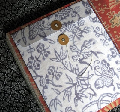 Beautiful floral and butterfly printed paper envelopes inside Victoria Alexander's book 'One', for cards and secrets.