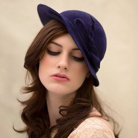 Alexandra is a luxurious vintage style tilt felt hat, sits to the side of the…