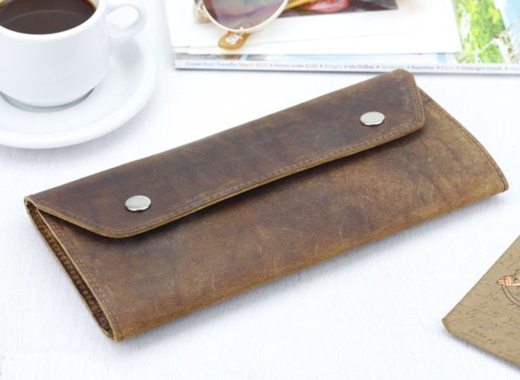 Our leather travel wallet has two side compartments for your travel documents and passport on one side and a generous zipped compartment on the other for coins, cards and notes. #travelgift #accessory #wallet #leather