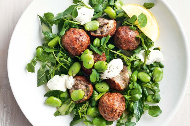 These delicious lamb meatballs are served on a bed of tasty greens.