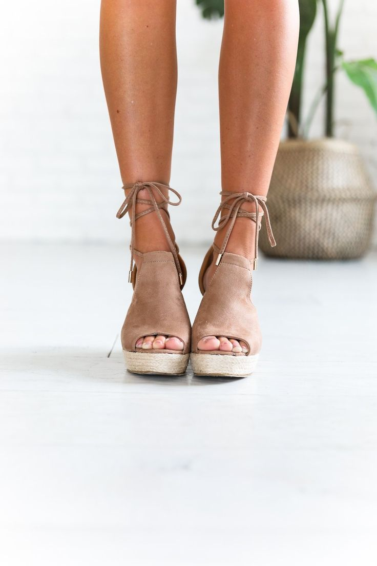 "• Suede, taupe, peep toe wedge espadrille • Available in sizes 5.5 - 10 U.S. Standard Sizing • Approximately 3"" high"