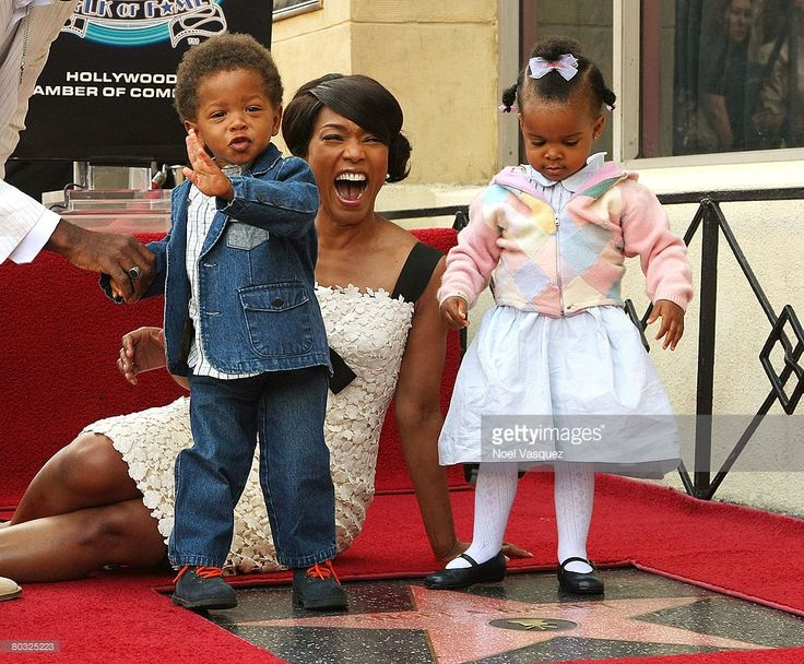 Angela Bassett and her children attend the ceremony honoring her with a star on the Hollywood Walk of Fame on March 20, 2008 in Hollywood, California.