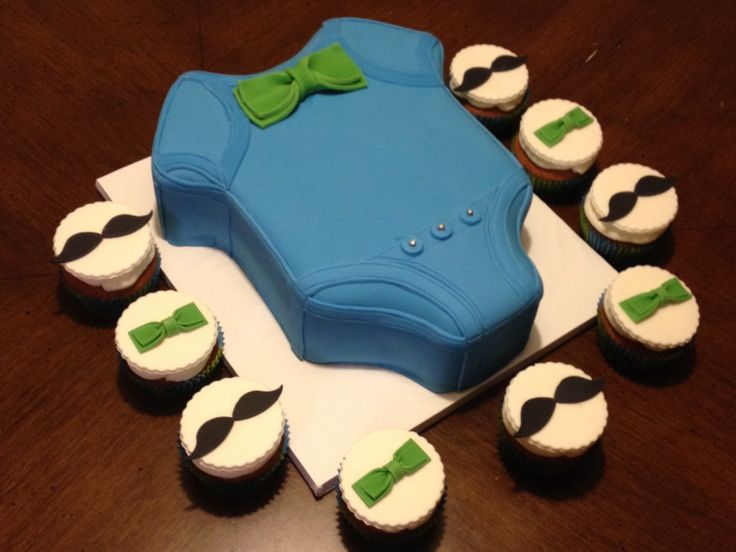 Onesie baby shower cake and cupcakes.