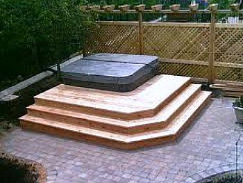 hot tub deck on paver patio