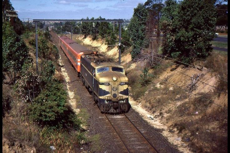 Electric loco L1169 hauls a Melbourne bound VLine passenger train out of Traralgon, Vic, 1984.