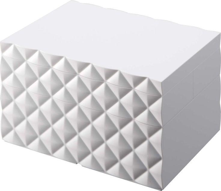Make-up doos met geometrische vormen.