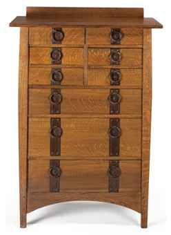 Gustav Stickley oak and beech tall chest of drawers, c. 1910-12. Copper hardware and iron studs.