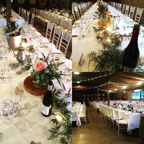 Greenery garlands and florals on timber rounds at beautiful Peppers Creek Barrel Room