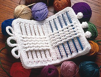 A Crochet Hook Case with free pattern. I love the inside, but would probably do the outside with two alternating colors of stripes instead of the rainbow of colors.