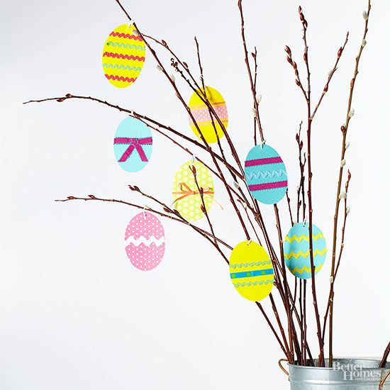 Make yourself a too-cute Easter centerpiece for just pennies that kids and adults will adore. Simply cut out Easter egg shapes from construction paper, and decorate using ribbon, markers, and stickers. Hang the eggs from a collection of pussy willow branches held in a vase or bucket.