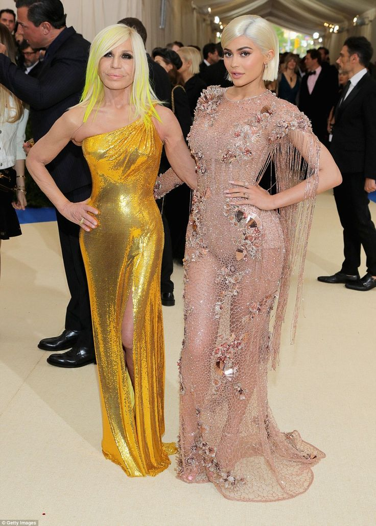 Dressed by the best: Kylie posed with designer Donatella Versace as the pair arrived at the ball