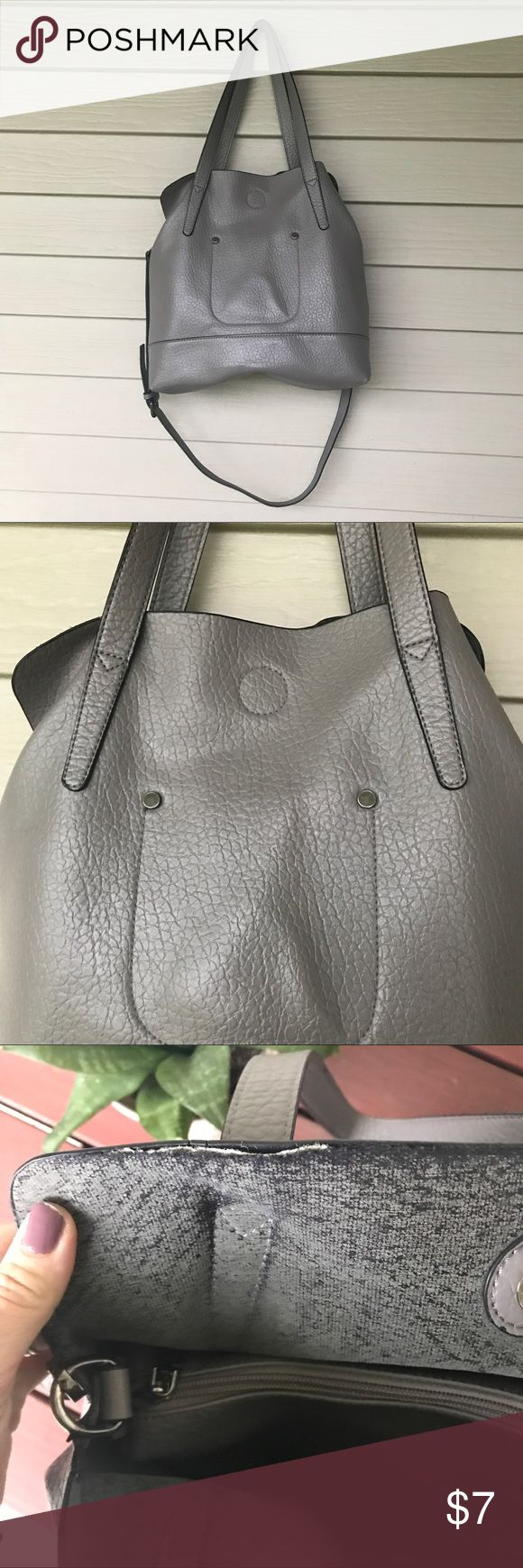Light grey shoulder/cross body bag Light grey shoulder/cross body bag. Has definite signs of wear (it was well loved 😉), but there's still some life left! The middle section can be removed to create more space and could even be used as a clutch! Bags Shoulder Bags