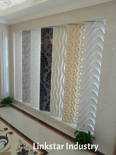 Decorative 3d feature stone panels are listed in a distributor's showroom for the client to select.