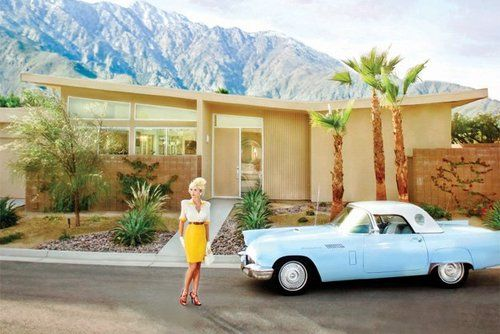 Mid-century modern fantastic butterfly house and vintage Thunderbird. This scene almost looks like a toy set.