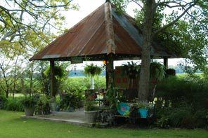 The rusty recycled tin used for the roof of the gazebo creates a shady retreat for painting or visiting with guests.1095237