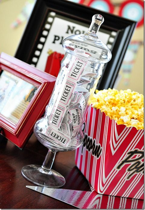 I am absolutely in love with this movie birthday party complete with ticket counter snack stand, popcorn cupcakes and boxcars to sit in!! Wondering if I can get Dylan to do this :)