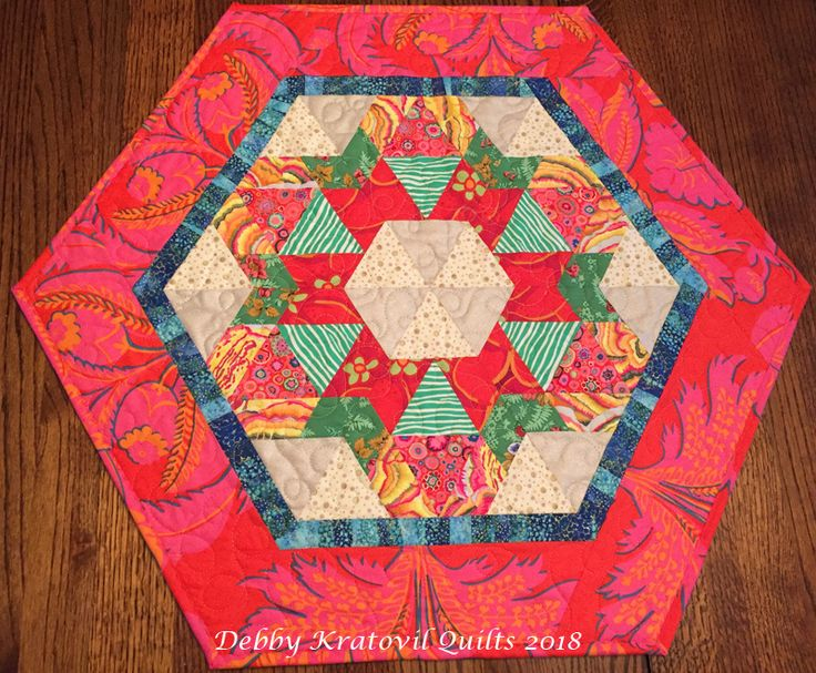 Six blocks from The New Hexagon Calendar. I used a variety of Kaffe fabrics and a Brandon Mably Brocade border. I love this table topper!