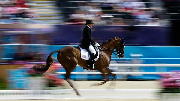 Karen O'Conner of the United States competes with her horse, Mr Medicott, in the equestrian eventing dressage competition during the equestrian eventing dressage competition at Greenwich Park at the 2012 Summer Olympics, on July 28, 2012, in London.