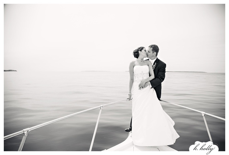 so in love with mindy's wedding! northern michigan - bride and groom on a boat!