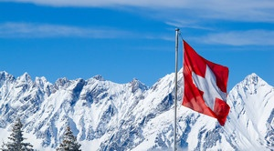 Snowy Alps with Swiss flag !