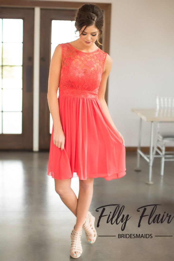 Add some playful details to your girl's bridesmaid dresses with this beautiful lace dress! This short bridesmaid dress features beautiful lace details across it's chest and subtle chiffon layers throu