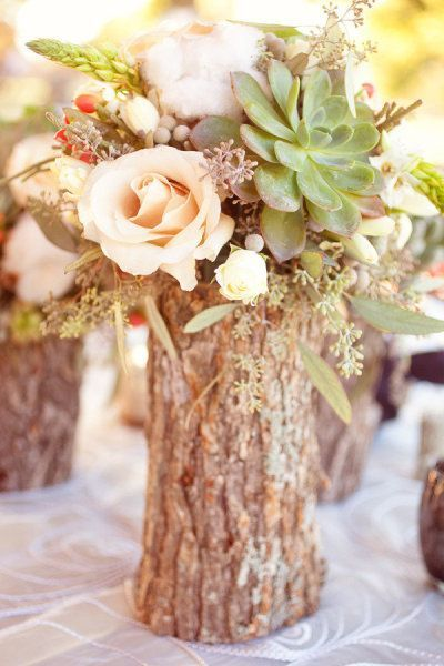 Timber centerpieces. Drill out the middle an use as a vase. Keeping it natural