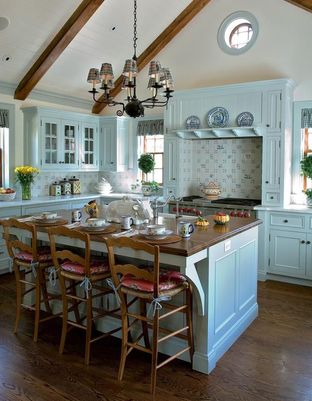 Pale Blue Kitchen Cabinets with Wood Topped Island and Tile Backsplash - on HGTV