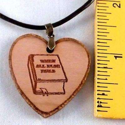 Custom engraved heart with bible when all else fails wood necklace.