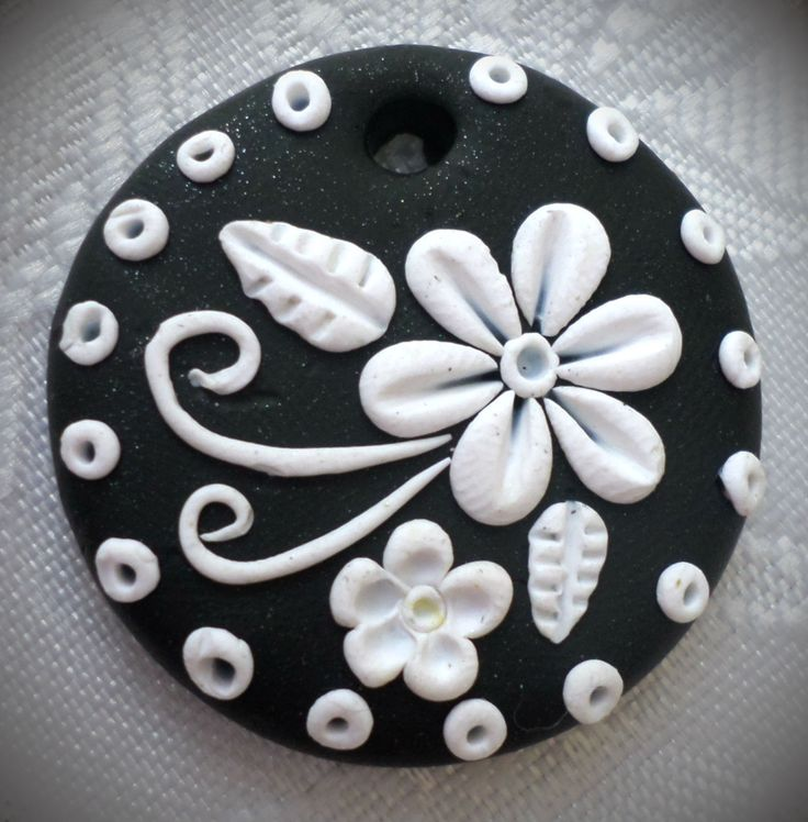 Polymer clay pendant, handmade with applique technique, one of a kind. Black with white flowers, swirls leaves and dots. By Lis Shteindel.