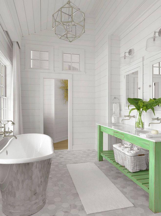 Bathroom. Beach style bathroom with distressed freestanding green vanity and large hex floor tiles.